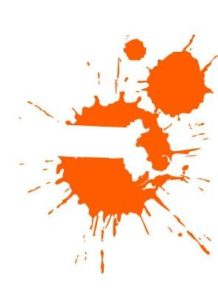 Two splatters of orange paint, one in the center and a smaller one above and to the right. The center splatter has a white, negative-space shape of Massachusetts in it.